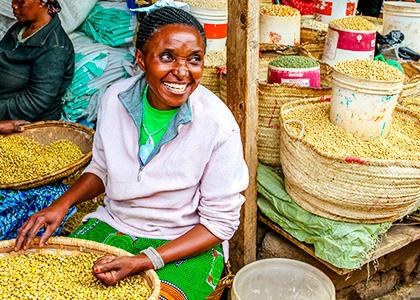 Afrikansk dame sælger krydderier